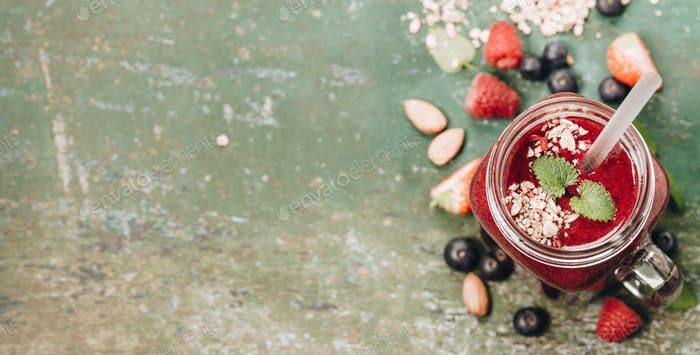 Berry smoothie on rustic background, copy space