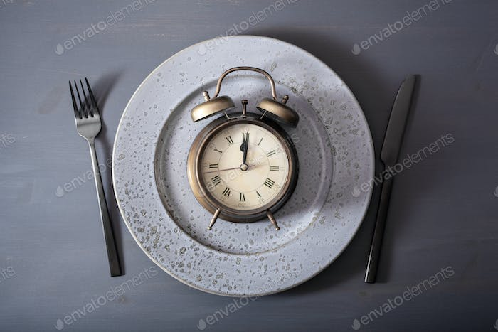 concept of intermittent fasting, ketogenic diet, weight loss. fork and knife