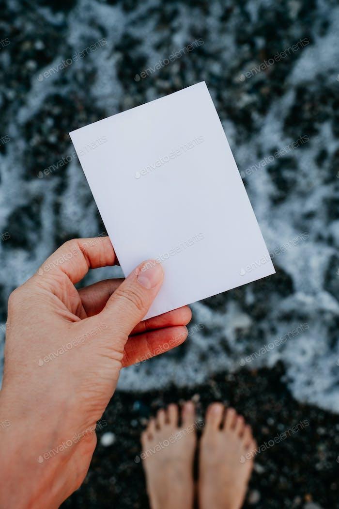 Empty paper note in hand