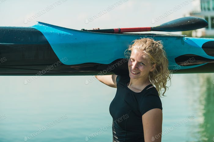 Female kayaker with her boat