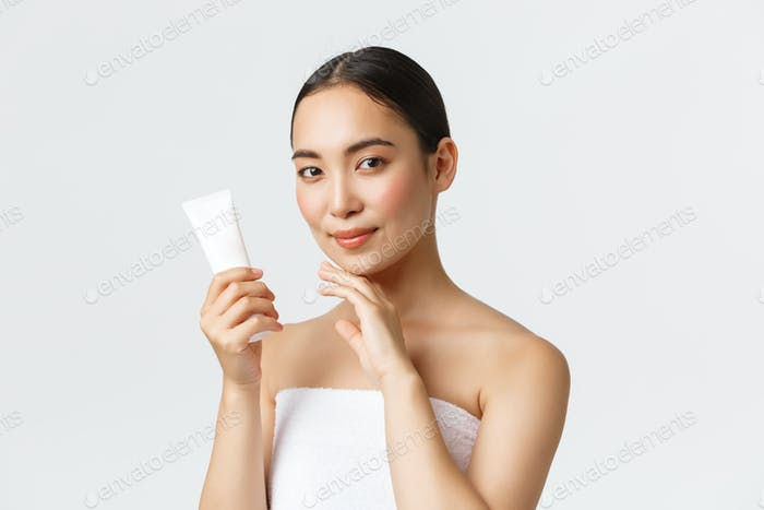 Beauty, personal care, spa salon and skincare concept. Young beautiful asian woman in bath towel