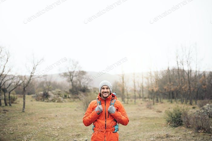 Young Backpacker enjoying of Nature.