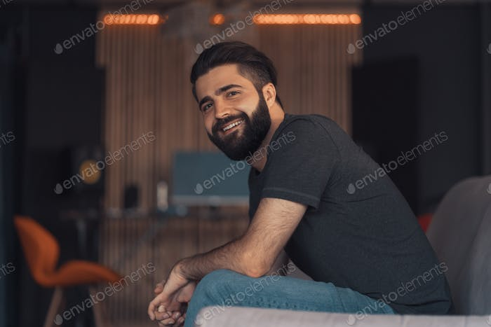 Young man sitting relaxing on the couch