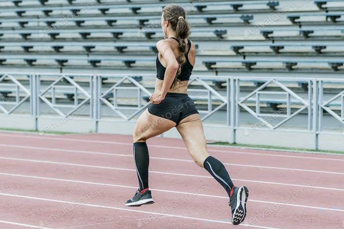 Slim woman athlete running