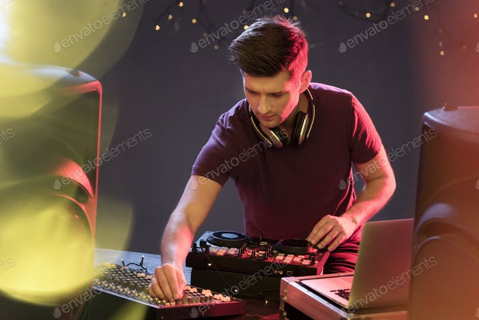 Passionate dj at turntable