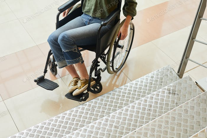 Disabled woman trying to move up the stairs
