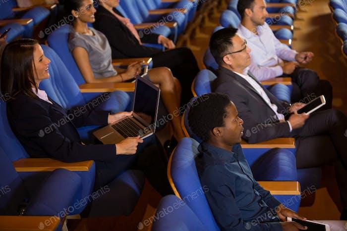 Business executives listening to speech
