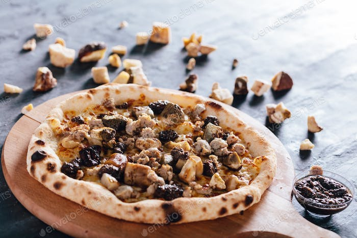 Pizza with porcini mushrooms, sausage and truffle sauce