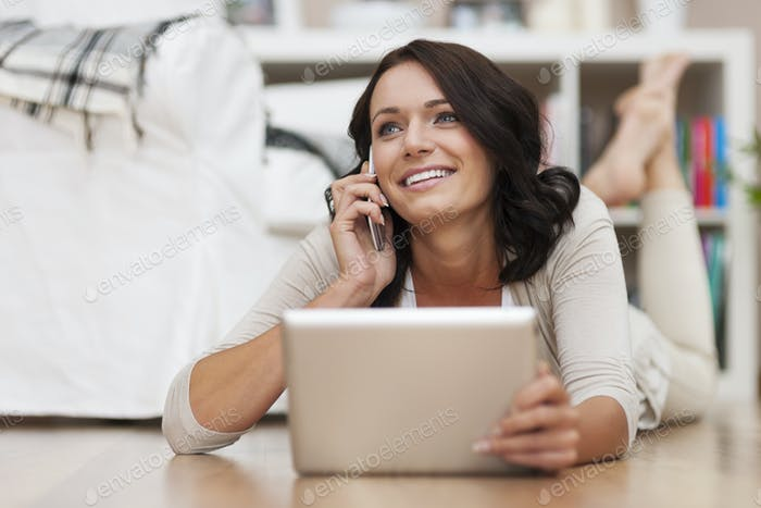 Beautiful woman using from contemporary technology at home