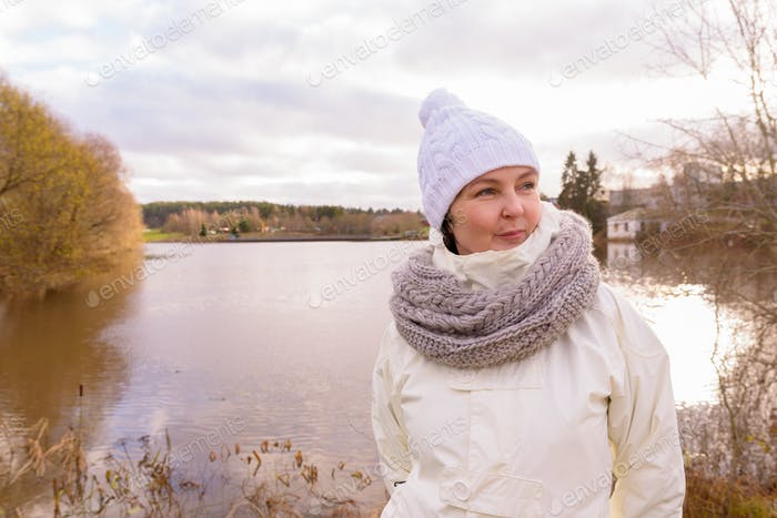 Mature beautiful woman getting away from it all with nature
