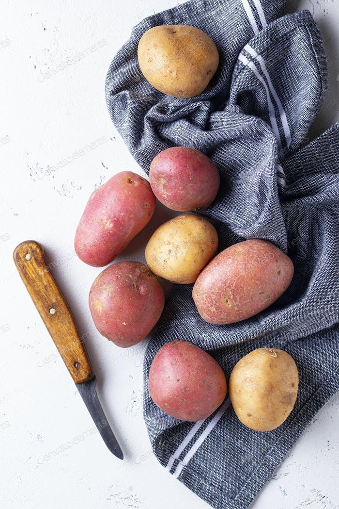 Various sorts of raw organic potatoes