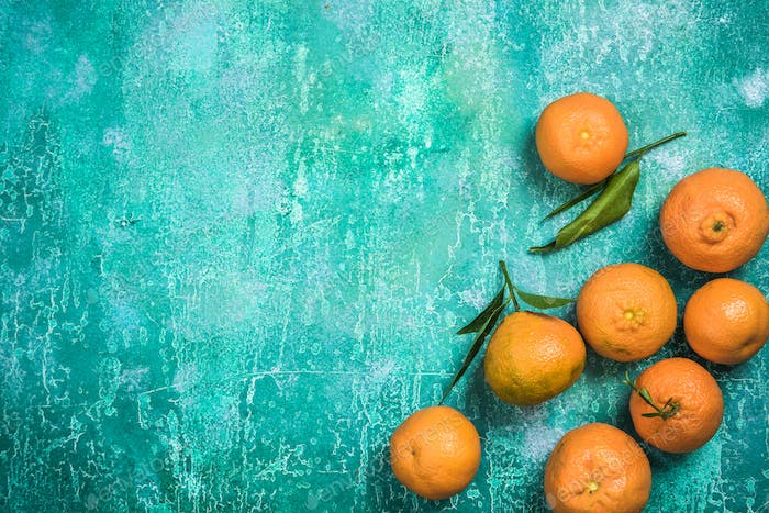 Ripe fresh clementines on concrete slate painted background