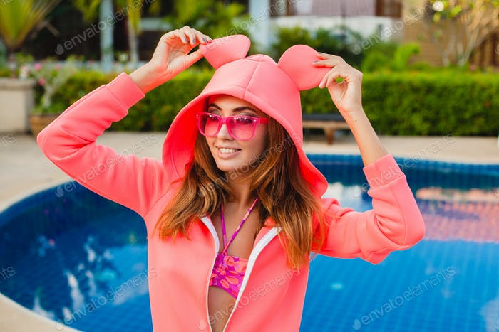 attractive woman in colorful pink hoodie