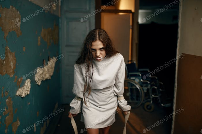 Female patient in a fit of rage, mental hospital