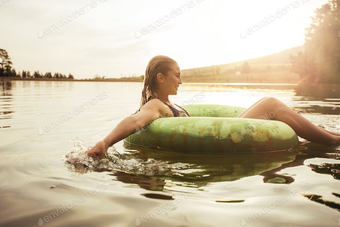 Young woman relaxing in water on a summer day
