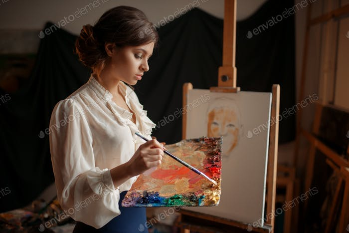 Female artist with color palette and brush