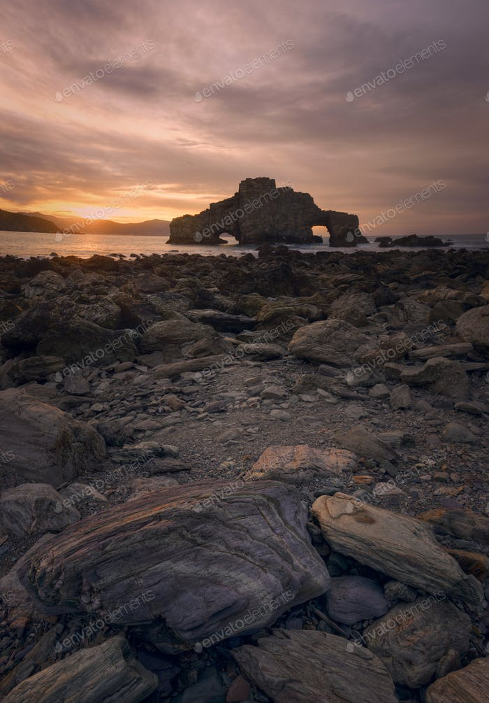 Tranquil sunset on a rocky beach