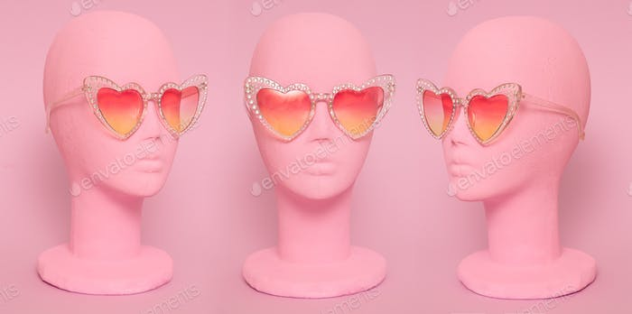 Mannequin in heart vintage sunglasses. Fashion eyewear accessories concept