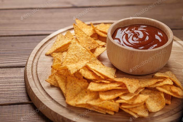 Chips nachos with ketchup. Concept - bad food, cafe, pub, party