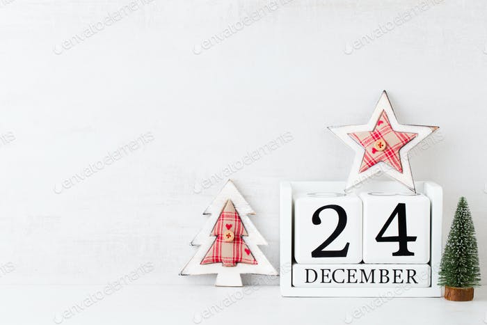 Christmas backgrounds. Christmas calendar, 24 december on the gray background.
