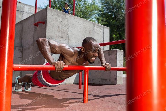 Athlete doing exercises at stadium