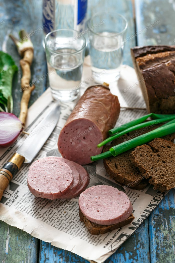 Sliced sausage with rye bread, onion and vodka