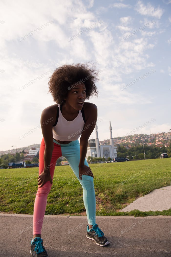 Portrait of sporty young african american woman running outdoors