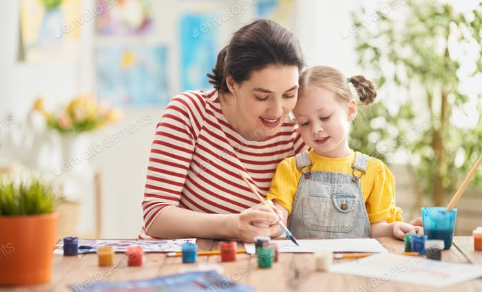 Happy family painting together.