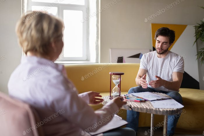 Psychologist and client analyzing test
