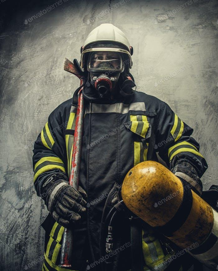 Portrait of firefighter in safety uniform.
