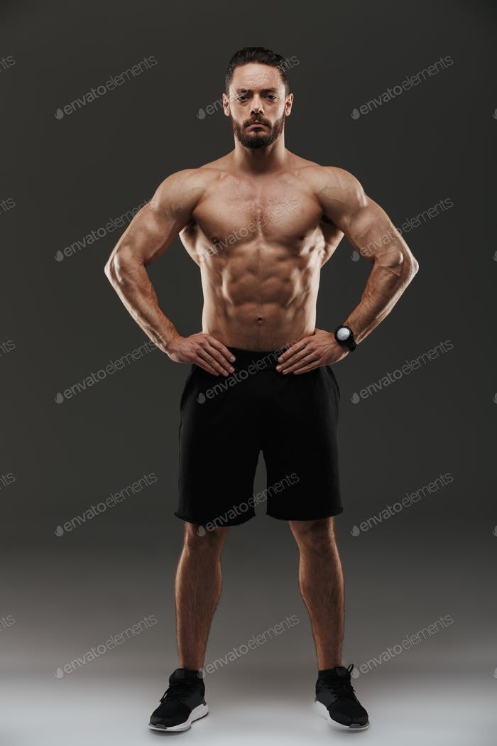 Full length portrait of a motivated muscular man posing