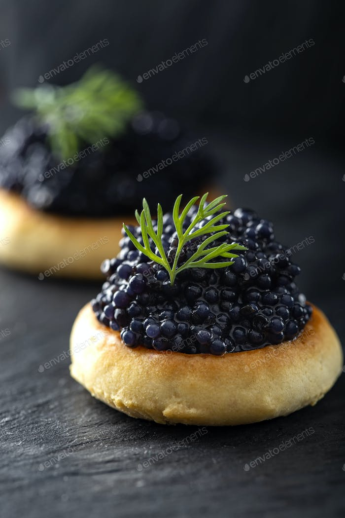 Crackers with black caviar