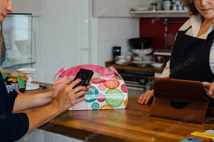 Woman paying for cake