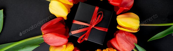 Banner of Gift, present box with red and yellow tulip around