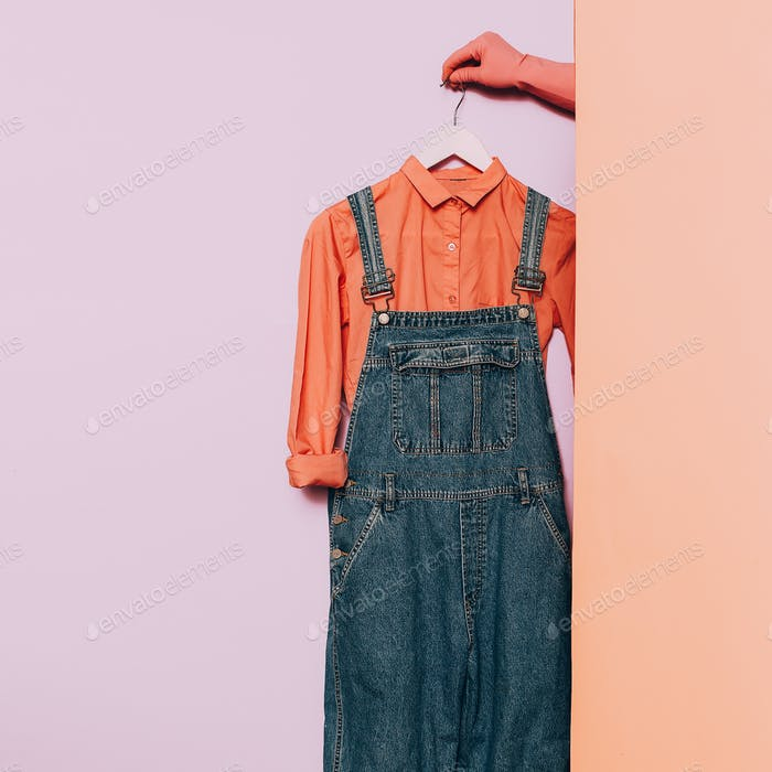 Stylish clothes. Hipster fashion. Pink shirt and denim overalls