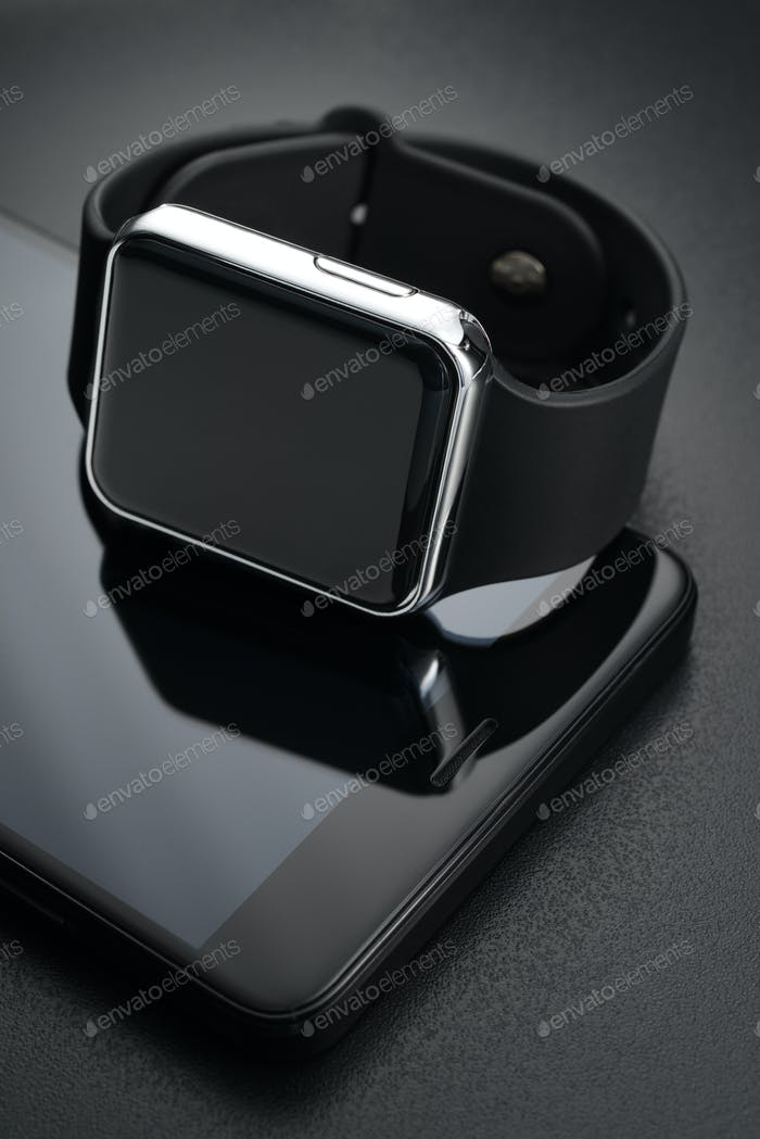 Black smart wrist watches and smartphone
