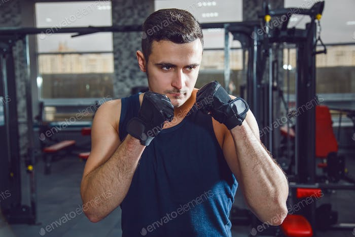 Portrait of boxer posing at gym