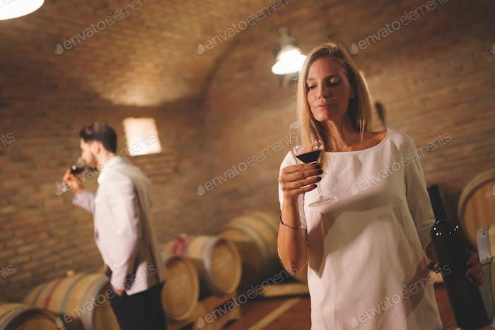 People tasting wine in winery
