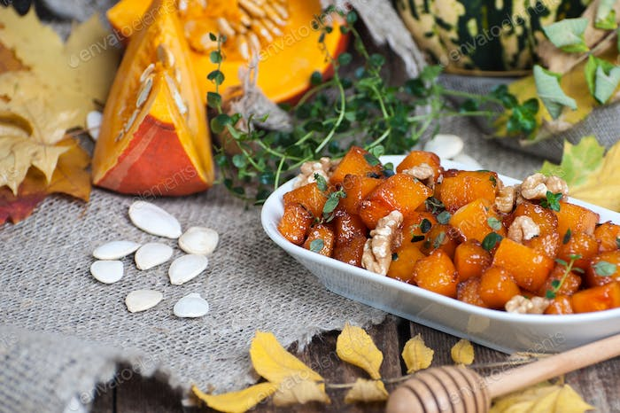 Fried pieces of pumpkin with honey, walnuts and thyme.