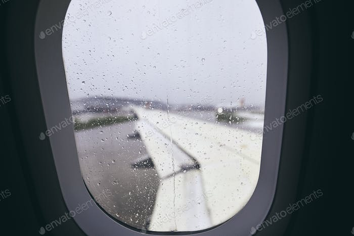 Airplane window during rain
