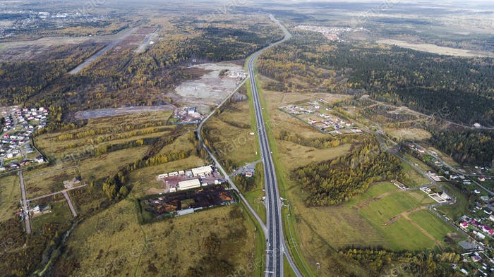 Aerial view of highway interchange Road junction Aerial photo of a highway going through the forest