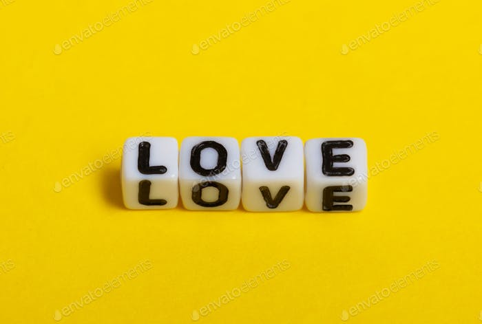 Love text on yellow background.