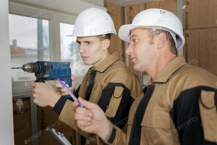portrait of builder with an electric drill