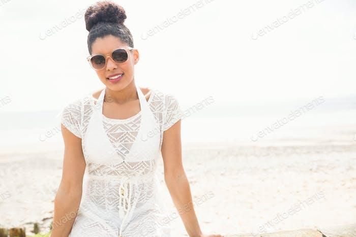 Pretty woman in sun dress at the beach