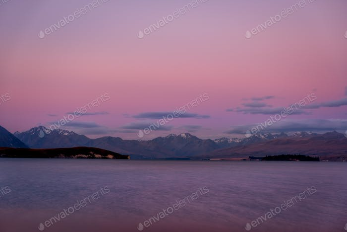 Colorful dreamy landscape of Lake Tekapo at sunset, New Zealand
