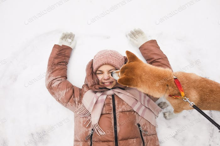 Cute Girl Playing in Snow