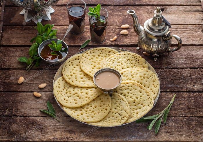 Baghrir with honey, almond sauce and mint tea