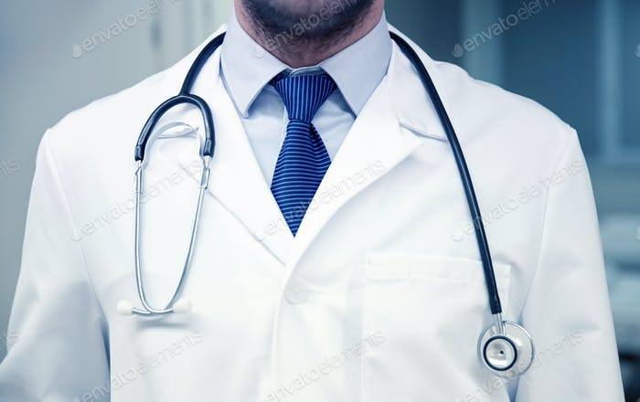 close up of doctor with stethoscope at hospital