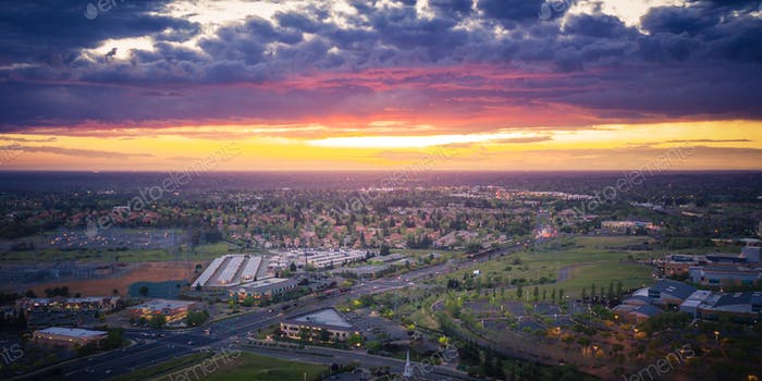 Aerival view of typical american suburb at sunset