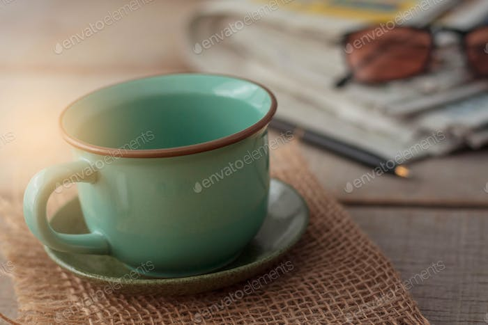 Cup and stationery on desk